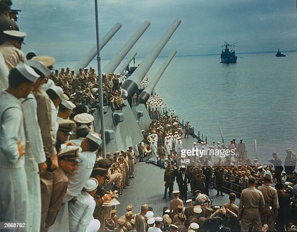 Soldiers and sailors on the decks of the USS Missouri to watch the Japanese surrender which was signed on board 2nd September 1945