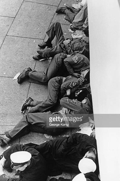 Soldiers and sailors sleep on the pavement outside Buckingham Palace as they wait to see the Queen on her Coronation London 2nd June 1953 Original...