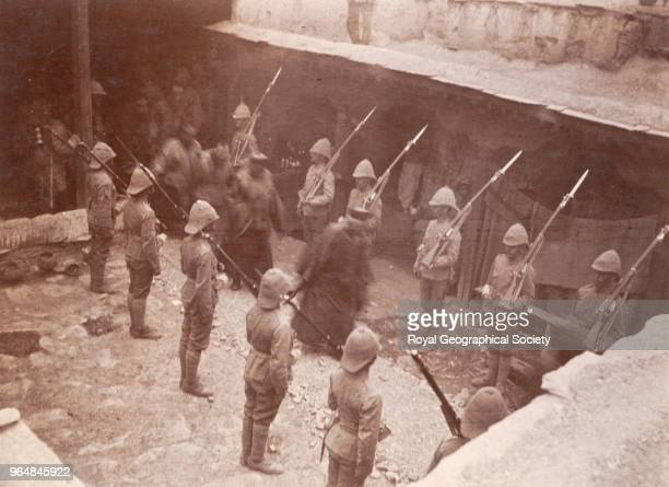 Soldiers and Tibetans Soliders with bayonets allow senior Tibetan officials to pass out of one of many meetings with Younghusband and his staff...
