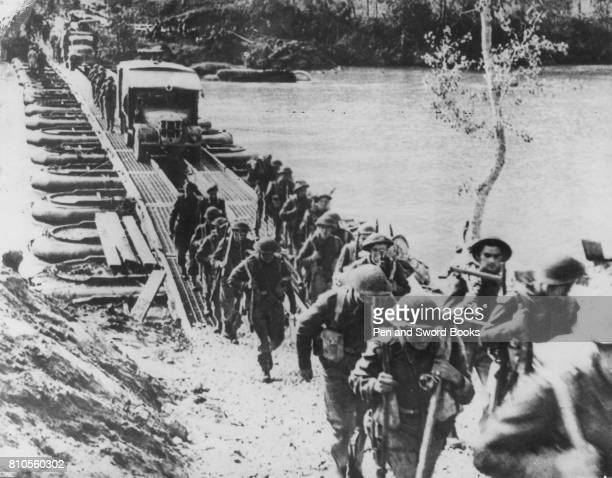 Soldiers and Vehicles Crossing a Pontoon Bridge.