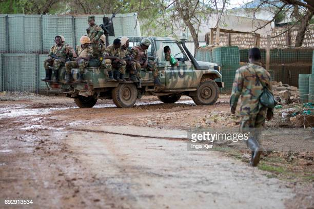 Soldiers are driven into a barracks on the loading area of a van on May 01 2017 in Baidoa Somalia