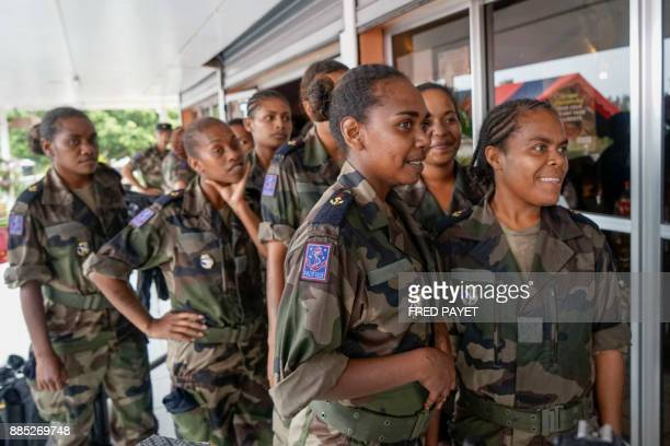 Soldiers are gathered during a visit of French Prime Minister at a military base in Grande Terre island on December 4 2017 in Koumac as part of his...