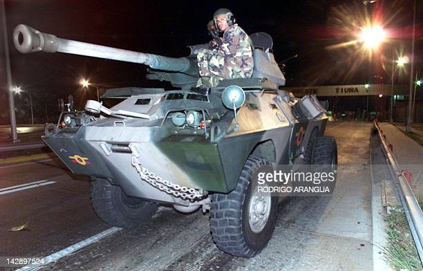 Soldiers are positioned atop an armoured personnel carrier at the Fort Tiuna 12 April 2002 in Caracas where ousted Venezuelan president Hugo Chavez...