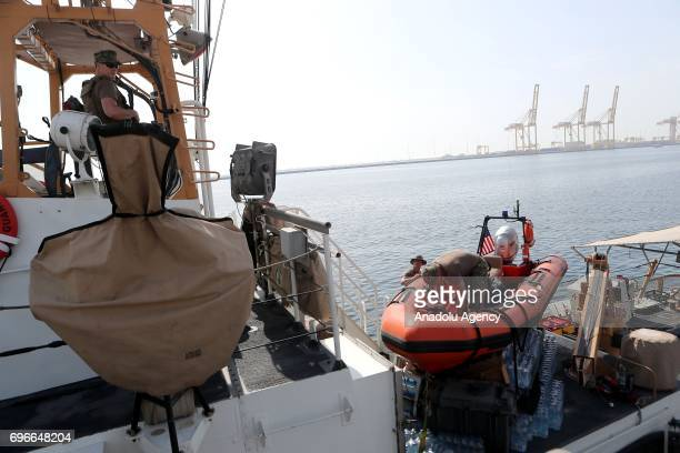 Soldiers are seen at Hamad Port in Doha Qatar on June 16 2017 After 12 billion dollars worth F35 fighter jet agreement United States and Qatar...