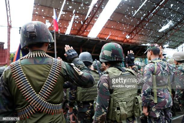 Soldiers are seen during a flag raising in the frontline in Bangulo village of Marawi City in the Southern Philippines on October 17 2017 President...