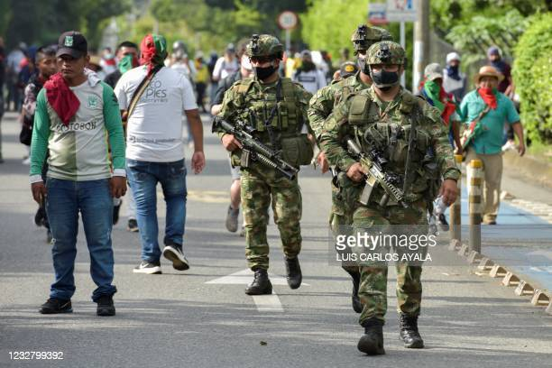 Soldiers are seen during clashes between indigenous people and citizens who oppose blockades set by demonstrators during protests triggered by a now...