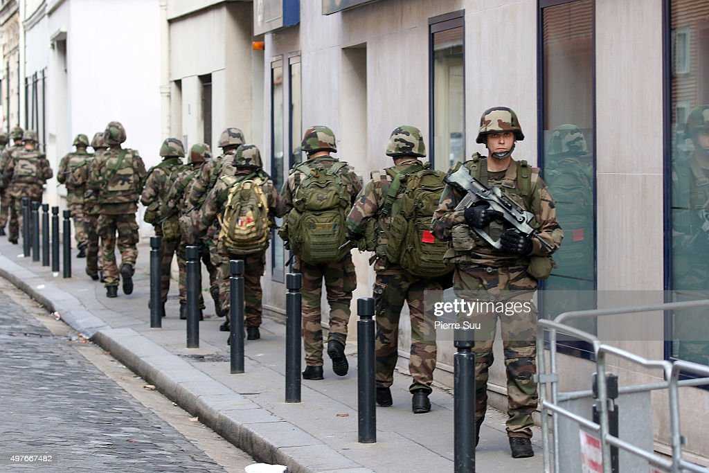 Soldiers are seen patrolling a street of Saint Denis on November 18, 2015 in Saint-Denis, France. French Police special forces raided an apartment, hunting those behind the attacks that claimed 129 lives in the French capital five days ago. At least one person was killed in an apartment targeted during the operation aimed at the suspected mastermind of the attacks, Belgian Abdelhamid Abaaoud. At least five police officers have been wounded in the shootout.