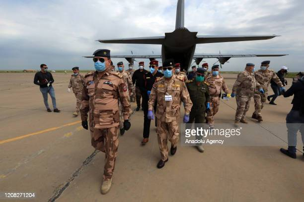 Soldiers are seen with face masks as the U.S.-led coalition against the Daesh/ISIS terror group on Thursday formally handed over to Iraq the Qayyarah...