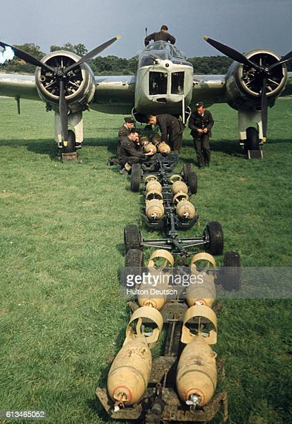 Soldiers arm a Blenheim MkIV Bomber with ammunition