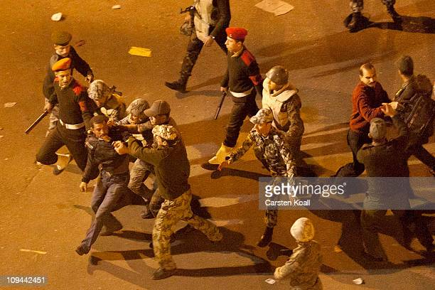 Soldiers arrest a protester near Tahrir Square Feburary 26 2011 in Cairo Egypt Soldiers fired in the air and used batons on protesters who were...