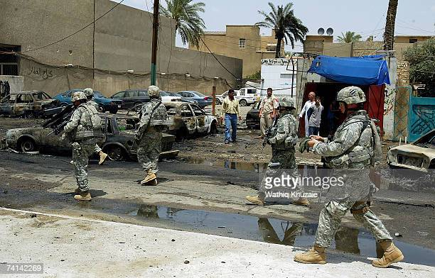 S soldiers arrive at the site of a car bomb explosion on May 14 2007 in Karrada Shiite neighborhood in Baghdad Iraq A car bomb exploded at a parking...