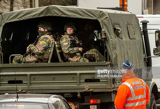 Soldiers arrive in a security perimeter set around the Maalbeek metro station on March 23 2016 in Brussels one day after the attack that killed 20...