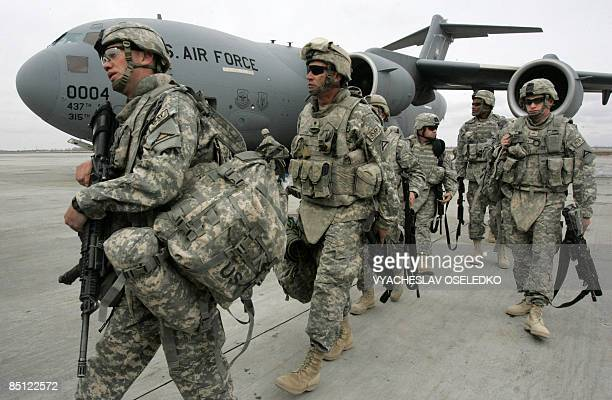 US soldiers arrived from Afghanistan walk outside a plane at the US airbase 30 km outside Bishkek in Manas on February 26 2009 The soldiers who had...