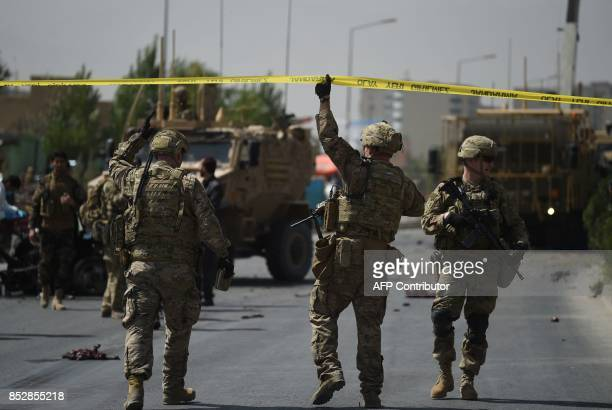 Soldiers arrives at the site of a car bomb attack that targeted a NATO coalition convoy in Kabul on September 24, 2017. A suicide bomber targeting a...