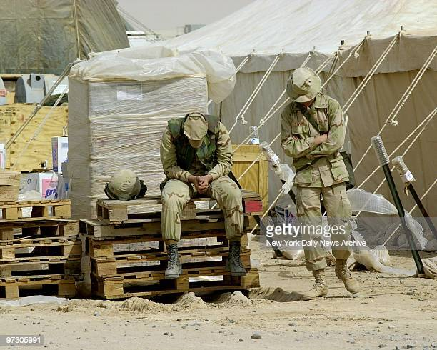 Soldiers at Al Jaber Air Base in the Kuwaiti desert prepare for war with lethal weaponry Marines wait for sun for orders at the air field