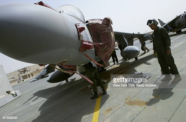 Soldiers at Al Jaber Air Base in the Kuwaiti desert prepare jets for battle American troops and equipment are massed in Kuwait in readiness for a...
