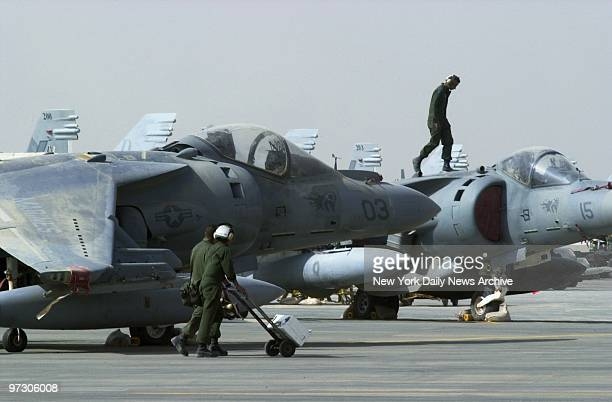 Soldiers at Al Jaber Air Base in the Kuwaiti desert work to get jets in battleready condition American troops and equipment are massed in Kuwait in...