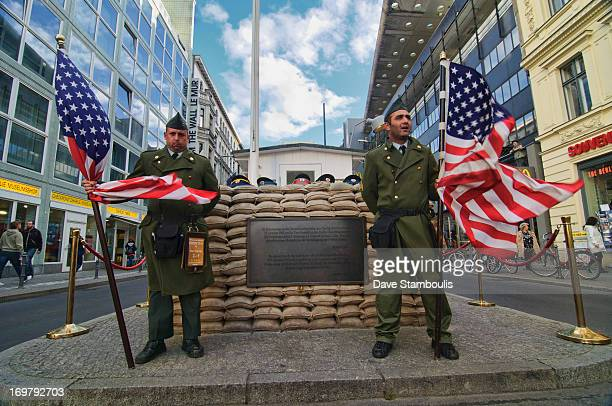CONTENT] soldiers at Checkpoint Charlie historical site in Berlin Germany