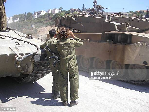 CONTENT] IDF soldiers at Metulla salute a tank returning from Lebanon during the 2006 war against Hezbollah