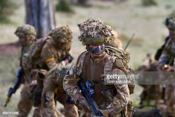 Soldiers attached to a company comprising a storied regiment of predominantly Nepalese recruits in the British army prepare for an overnight...
