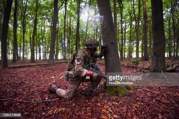 Soldiers attack enemy positions in woodland during a training exercise on Salisbury Plain Training Area on July 03, 2020 in Salisbury, England. 5...