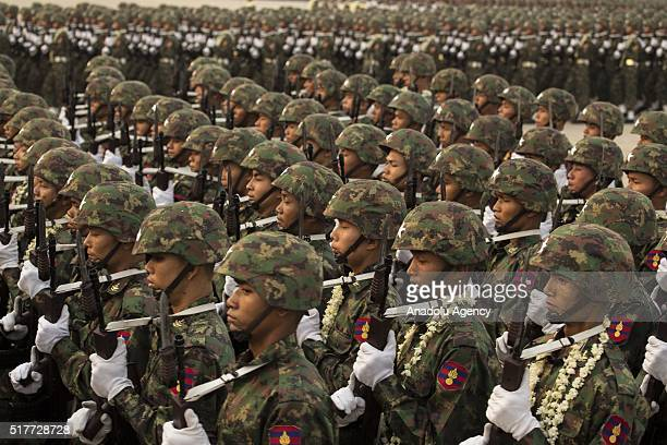 Soldiers attend a military parade as Myanmar marks the 71st Armed Forces Day in Nay Pyi Taw on March 27 2016 in commemoration of the beginning of the...