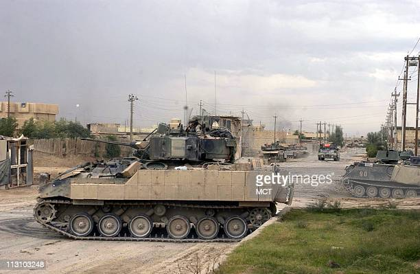 US soldiers battle insurgents in the northern district of Fallujah Iraq on Saturday November 13 2004