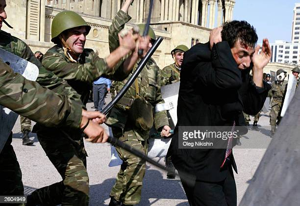 Soldiers beat an Opposition supporter of the Musavat party during riots October 16 2003 in downtown Baku Azerbaijan People in this oilrich Caspian...
