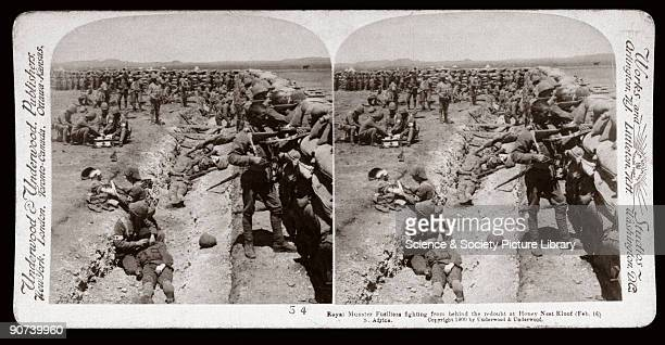 Soldiers behind a sandbagged redoubt Wounded are being tended suggesting a recent attack One of a boxed set of stereoscope photographs produced for...