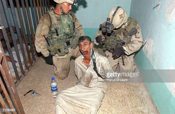 S Soldiers belonging to the Army's Fourth Infantry Division and Task Force Ironhorse detain a man during a raid on July 1 2003 in Balad 76 km north...
