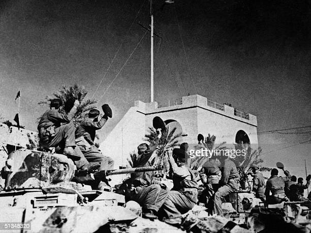Soldiers belonging to the Commonwealth and Allied forces celebrate in October 1942 while occupying the city of Tripoli the capital of Libya a Italian...
