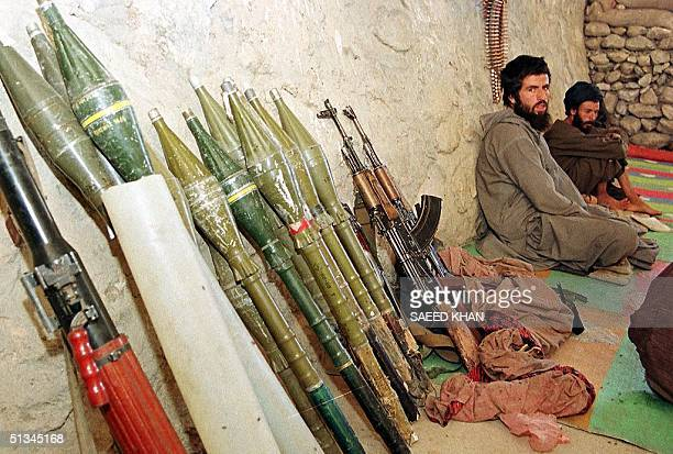 Soldiers belonging to the ruling Taliban militia wait in their bunker with their arms and ammunition for the signal from their commanders to attack...