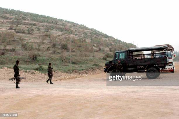 Soldiers block on May 5 2009 the road to the Turkish village of Bilge outside the southeastern Kurdish city of Mardin after masked gunmen stormed...
