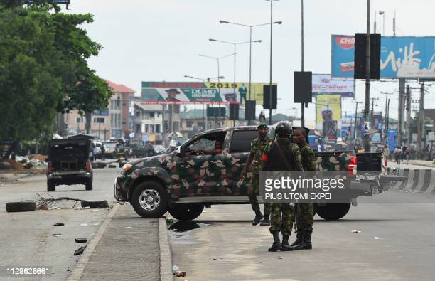 Soldiers block with a truck the road leading to the state headquarters of Independent National Electoral Commission in Port Harcourt Rivers State on...
