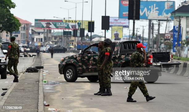 Soldiers block with truck and armoured tank the road leading to the state headquarters of Independent National Electoral Commission in Port Harcourt...