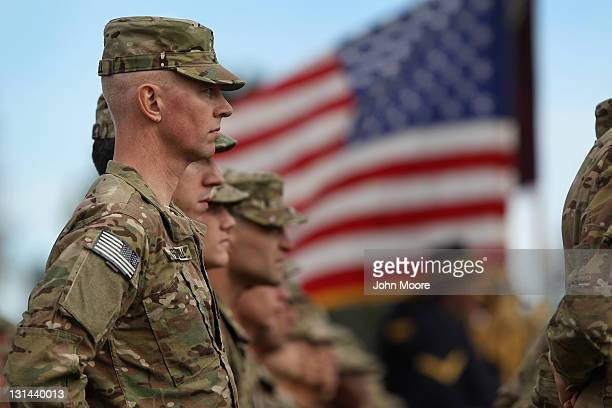 Soldiers bound for Afghanistan stand at parade rest during a departure ceremony on November 4 2011 in Fort Carson Colorado Some 250 medical soldiers...