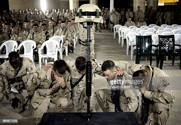 US soldiers bow their heads in mourning for one of their fallen comrades SGT Jerry Lee Bonifacio Jr from Bravo Company 1184 assigned to TF 464 3rd...