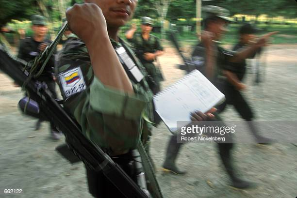 FARC soldiers break after a training exercise at FARC headquarters in Los Pozos Colombia August 25 2000 The FARC maintains a force of 15000 soldiers...