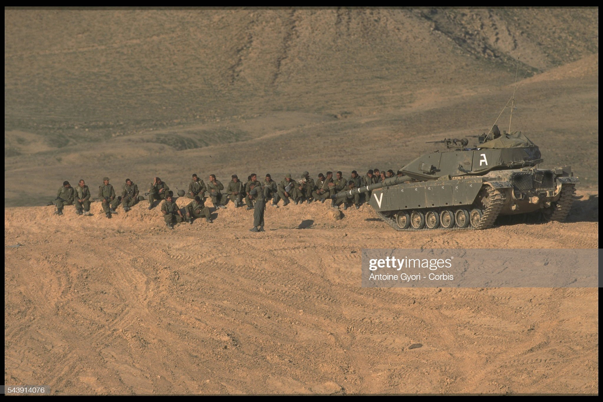 https://media.gettyimages.com/photos/soldiers-by-a-merkava-tank-picture-id543914076?s=2048x2048