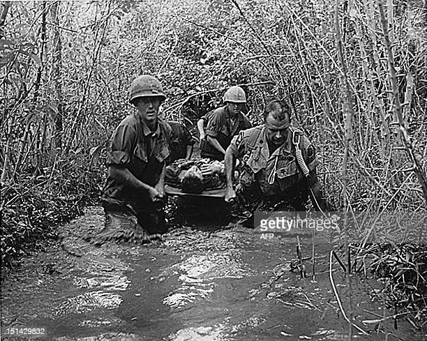 US soldiers carry a wounded comrade through a swampy area during action in Vietnam in 1969 AFP PHOTO/NATIONAL ARCHIVES