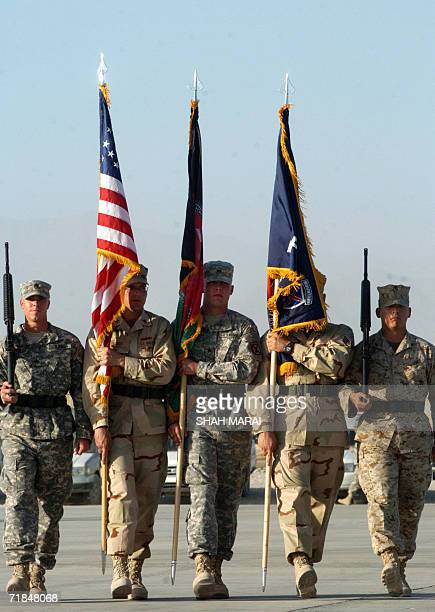 US soldiers carry flags during a ceremony at Bagram air base 50 kms north of Kabul 11 September 2006 in remembrance of the victims of the 11...