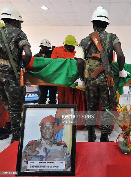 Soldiers carry on March 8 209 the coffin of GuineaBissau army chief General Batista Tagme Na Waie near his portrait in Bissau during a state funeral...