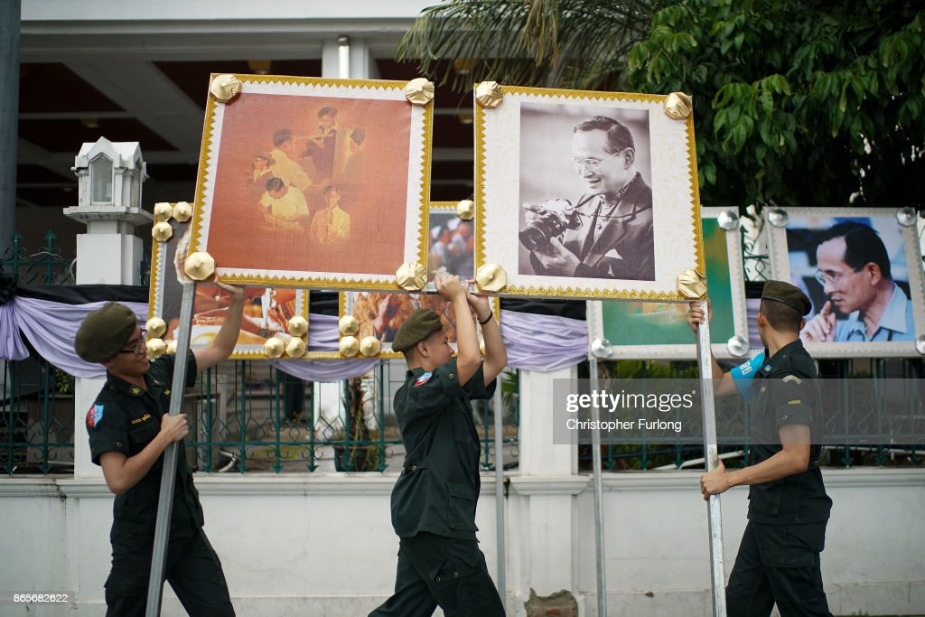 Soldiers carry portraits of Thailand's late King Bhumibol Adulyadej, in preparation of the King's cremation, on October 24, 2017 in Bangkok, Thailand. The world's longest serving monarch King Bhumibol Adulyadej died on October 13, 2016. Rehearsals for the five day funeral of the much loved king are taking place around Bangkok's Grand Palace. The ceremonies will take place over five days culminating in the cremation of the king's body in a grand Royal Crematorium on October 26th.