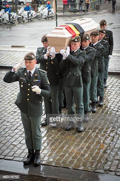 Soldiers carry Queen Fabiola's coffin during a funeral ceremony at Notre Dame Church on December 12, 2014 in Laeken, Belgium.