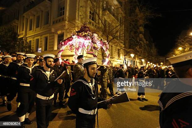 Soldiers carry the bier for the Epitaphios through the streets of Athens with sailors from the Greek Navy as honour guard Thousands of people lined...