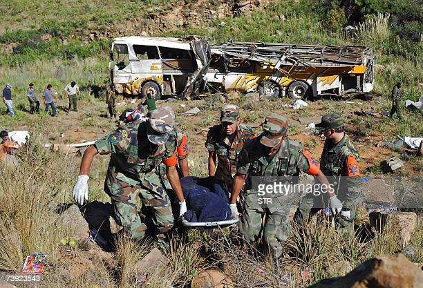 Soldiers carry the body of one of the 29 people killed in a road accident in central Bolivia, on April 19th, 2007. A bus plunged into a 150-metre...