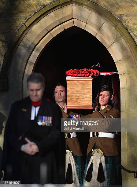 Soldiers carry the coffin of Captain Walter Barrie from The Royal Scots Borderers 1st Battalion the Royal Regiment of Scotland out of Glencorse Kirk...