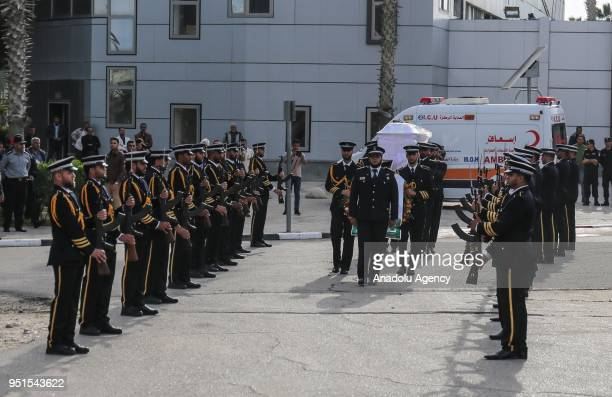 Soldiers carry the coffin of Fadi al-Batsh, a Palestinian Hamas-linked research engineer who was killed by unknown assailants in Kuala Lumpur during...