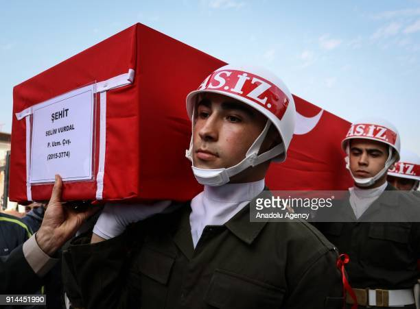 Soldiers carry the coffin of martyred specialized infantry sergeant Selim Vurdal who was martyred during the 'Operation Olive Branch' on the funeral...