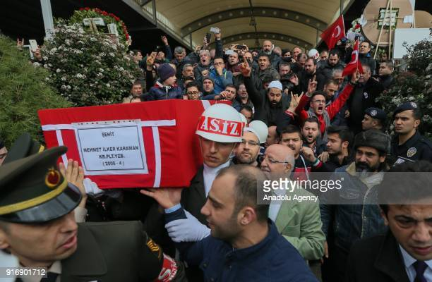 Soldiers carry the coffin of Staff Captain Pilot Mehmet Ilker Karaman who was martyred during Turkey's counterterrorist operation in northern Syria...